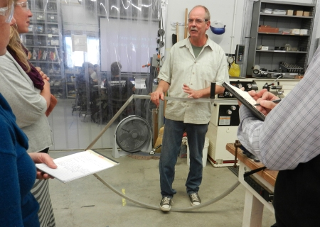 Science teacher Bruce Hamren shows Agency by Design researchers an early prototype for a speed crutch developed by students and faculty at the Athenian School to help young people in wheel chairs experience the feeling of jogging on a track.
