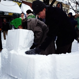 Recycling bins were strategically employed to create giant snow bricks for improvised snow fort construction at the Artisan's Asylum Snow Day Maker Party.