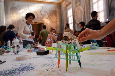 In an activity inspired by the Exploratorium's Tinkering Studio, participants in a tinkering workshop at Il Museo Nazionale della Scienza e della Tecnologia in Milan experiment with making scribbling machines.