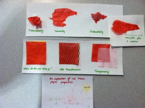A student in the Perspectives on Learning course explored the properties of red tissue paper when the tinkering table came to class.