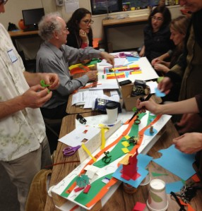 Members of the Temescal Learning Community using tactile materials to redesign systems in their community.