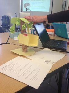 A teacher in the Temescal Learning Community shares a student-redesigned treehouse.