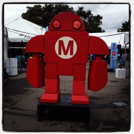 A giant sculpture of Make's maker mascot welcomes guests to a rainy start of the 2013 World Maker Faire.