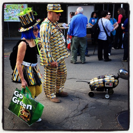 This couple clad in MetroCards was out walking their robot dog at the 2013 World Maker Faire (the outfits were cool—but the dog was even cooler!).
