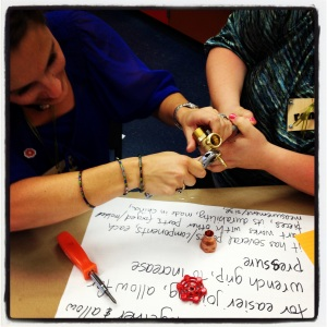 Teachers from the Oakland Learning Community get hands-on with their learning as they take apart a spigot.