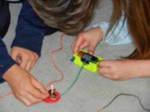 Students at Park Day School building props for student written plays with LED circuits.