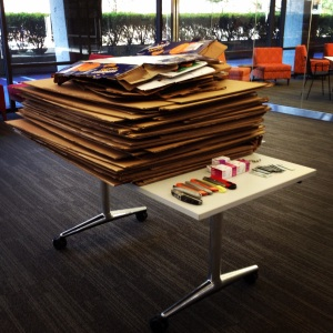 Stacks of cardboard, an assortment of box cutters, and dozens of document fasteners awaited our participants at the LEFT conference.