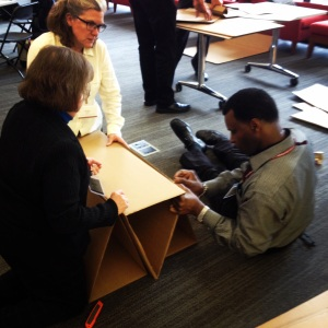 This was no ordinary conference session—participants were both up on their feet—and down on the floor—as they got to work on their cardboard chairs.